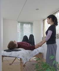 With the student lying down in a relaxed position,<br />   the instructor manipulates their body.